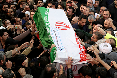 Iranian people carrying the coffin of Iranian Major-General Qassem Soleimani