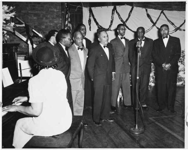 historic photo of singing group