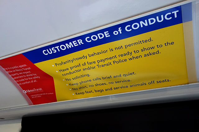 A Metro Transit code of conduct sign displayed on a Green Line train.