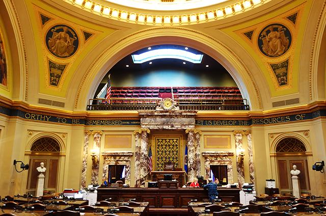 Capitol staffers preparing the Minnesota Senate chambers on Monday.