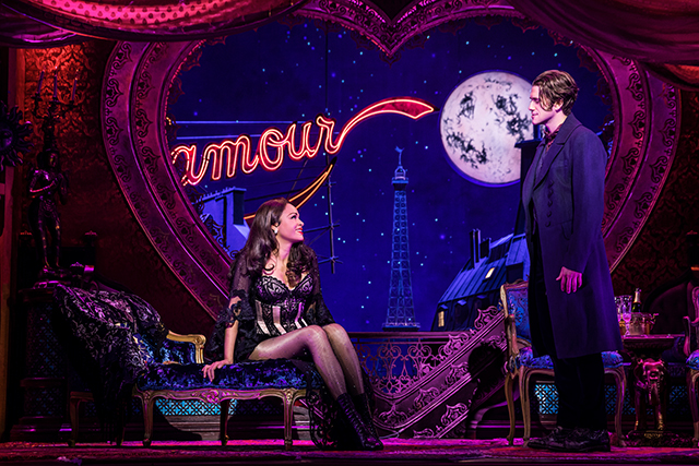 "Karen Olivo as Satine and Aaron Tveit as Christian in ""Moulin Rouge."""