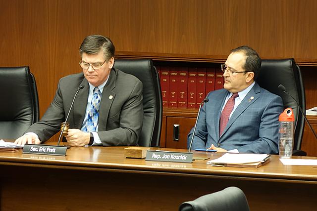 State Sen. Eric Pratt and state Rep. Jon Koznick shown at the beginning of Wednesday's hearing.