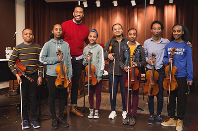 Roderick Cox shown with scholarship students from the Walker West Music Academy