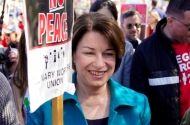 photo of amy klobuchar at a protest