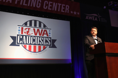 photo of iowa democratic party chair troy price speaking at a dais