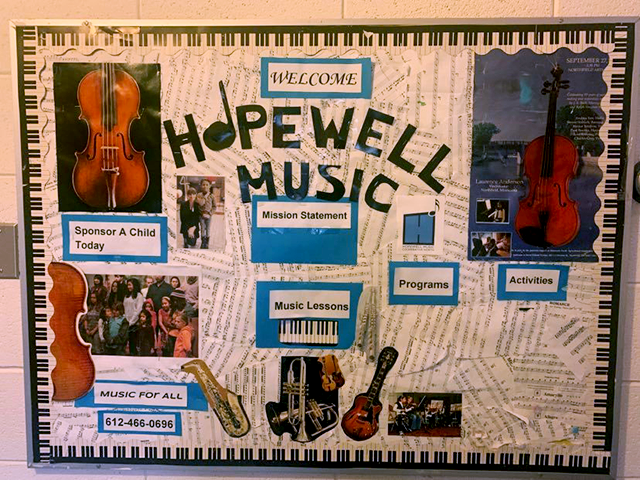 A sign on the stairwell of North United Methodist church welcomes all to Hopewell Music Cooperative North.