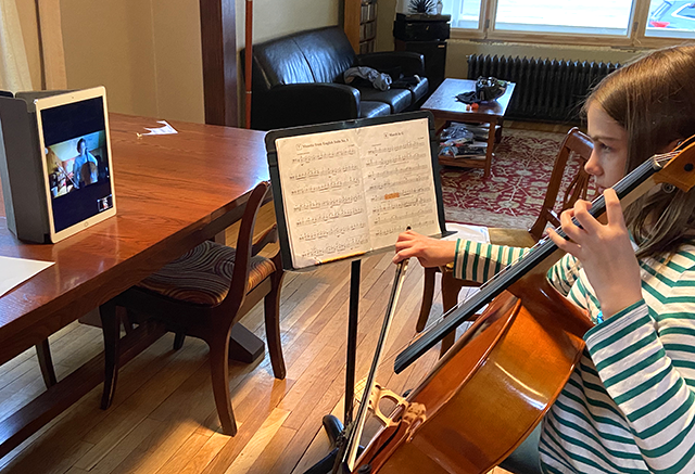 Wilson's daughter Anneli takes an online viola lesson from her teacher, Rebeccah Parker Downs of St. Joseph's School of Music.