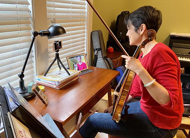Cara Wilson of St. Joseph's School of Music in her in-home music studio.