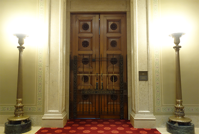 The doors to the chambers of the Minnesota Senate were closed.