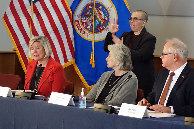 Infectious Disease Director Kris Ehresmann speaking during Friday's press conference as Health Commissioner Jan Malcolm and Gov. Tim Walz look on.
