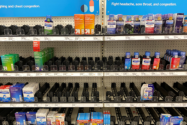 Empty cold and flu medicine shelves are shown at a Target store