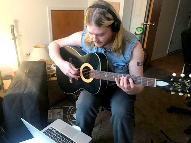 Joe Suihkonen of the Chicago-based School of Rock teaching guitar via computer