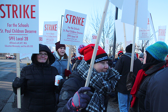 Teachers picketing outside of Johnson Senior High School on Tuesday morning.