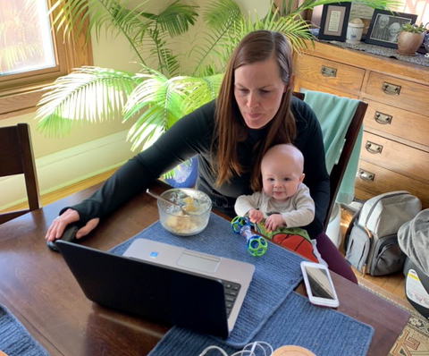 Harvest Best Academy EL teacher Kristin Shaver instructing students via FaceTime, while holding her 4-month-old baby.