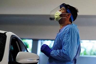 Medical personnel test a driver