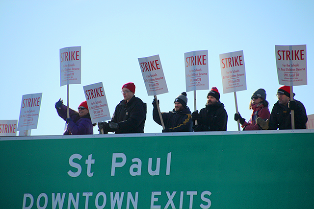 Mississippi Creative Arts Schools educators picketing on the Larpenteur/35E overpass on Tuesday.