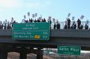 Mississippi Creative Arts Schools educators picketing on the Larpenteur/35E overpass