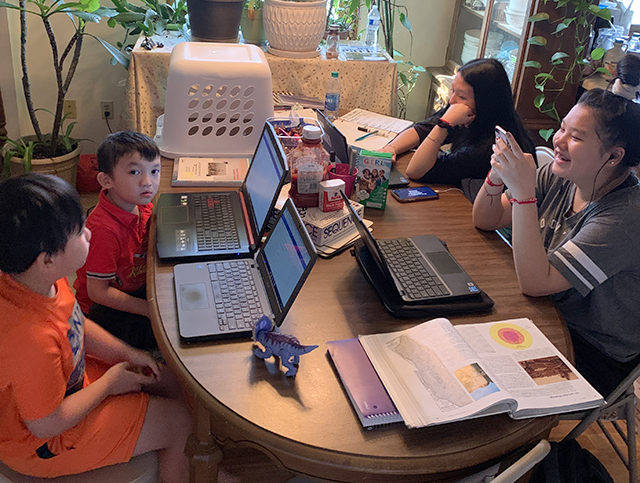 Pang Yang's four children, who attend Robbinsdale schools, shown during their first day of distance learning.