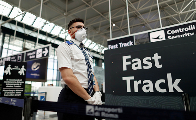 An airport employee wearing a protective face mask seen at Rome's Fiumicino Airport last Thursday.
