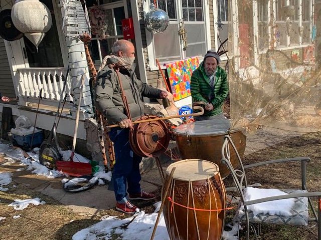Garth Galbraith and crew bang on the big drums in the front yard of Galbraith's house in south Minneapolis.