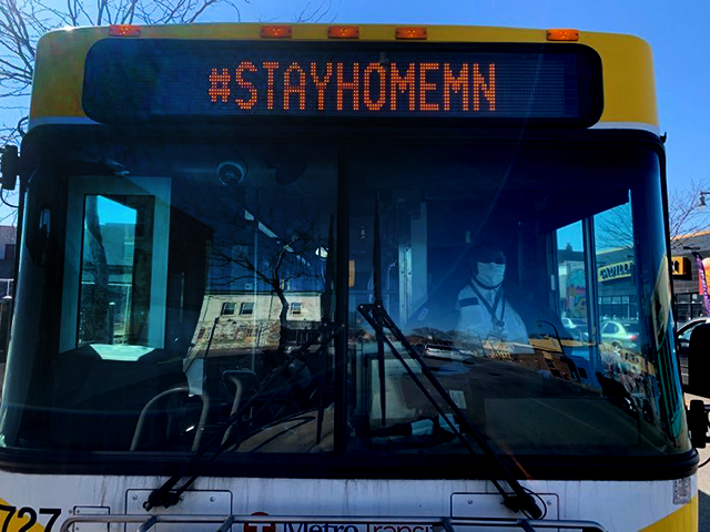 Masked Metro Transit bus driver John Morris drove the 21A down Lake Street Saturday.