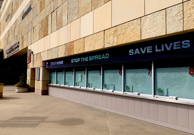 """Stay home Stop the spread Save lives"": Target Field, downtown."