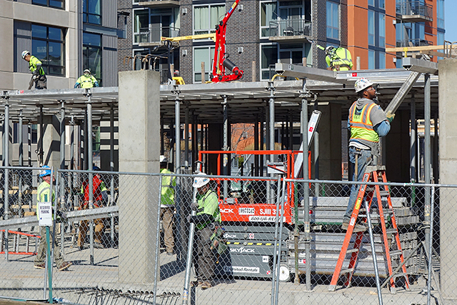 Construction workers working on a new apartment complex in the North Loop on Thursday.