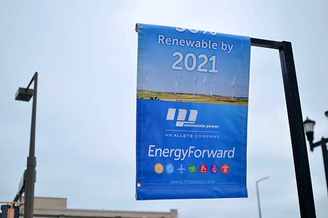 Signs hang in downtown Duluth promoting Minnesota Power's goal to produce 50 percent of its energy from renewable resources by 2021.