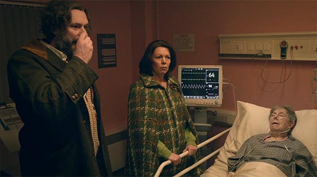 "Julian Barratt, Olivia Colman, and Leila Hoffman in an episode of ""Flowers."""