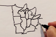 Al Franken drawing a map of the U.S.