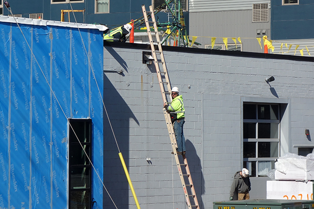 Construction workers adding on to the Fulton Brewing Taproom in the North Loop.