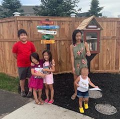 Mai Nhia Xiong-Chan's family and their Little Free Library in Apple Valley.