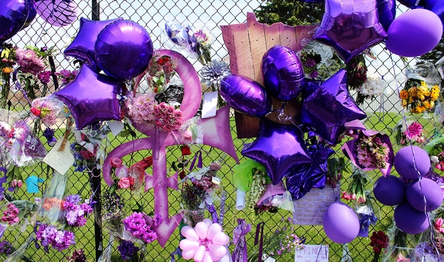 From April 23, 2016: Flowers, balloons, and artwork at the fence of Paisley Park in Chanhassen following the death of Prince.