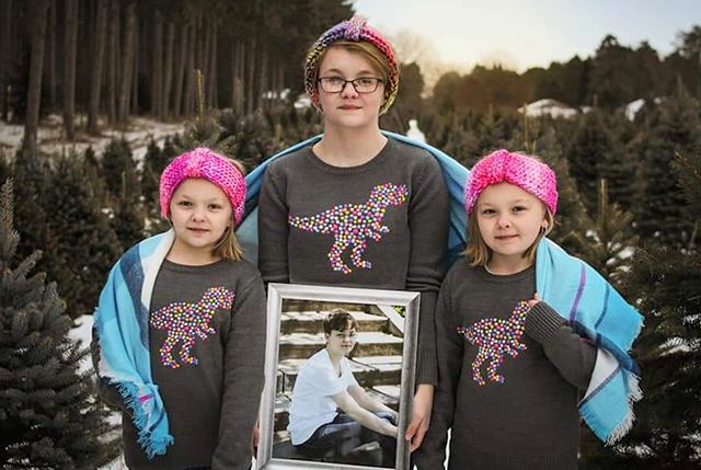 Hayden, Madison and Hailee Rogers holding a portrait of Dani.
