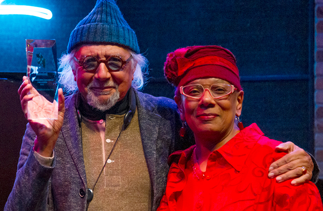 Janis Lane-Ewart presents jazz artist Charles Lloyd with a 2018 Jazz Journalists Association Award at the Dakota in March 2018.