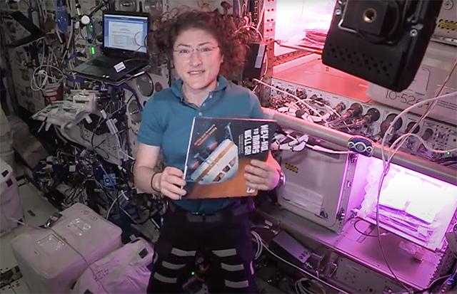 """Astronaut Christina Koch reading """"Hey-Ho, to Mars We'll Go!"""""""