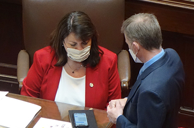 Senate Minority Leader Susan Kent speaking with her chief of staff John Pollard