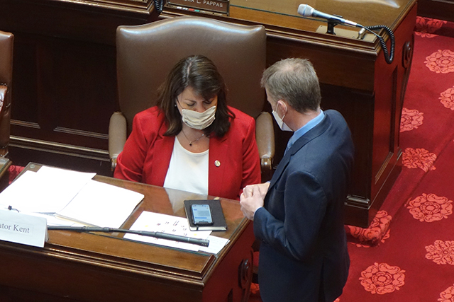 Senate Minority Leader Susan Kent speaking with her chief of staff John Pollard on Thursday.