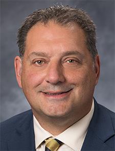 Commissioner Michael Jugovich