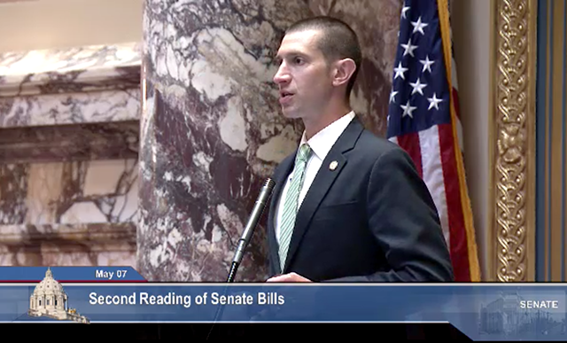 Sen. Jeremy Miller, presiding as president of the Senate sans-mask.