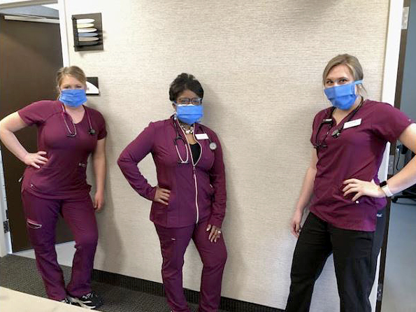 North Memorial staff members wearing the donated masks.
