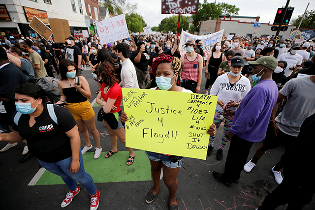 Thousands of protesters gathered on Tuesday night at the scene where George Floyd died.
