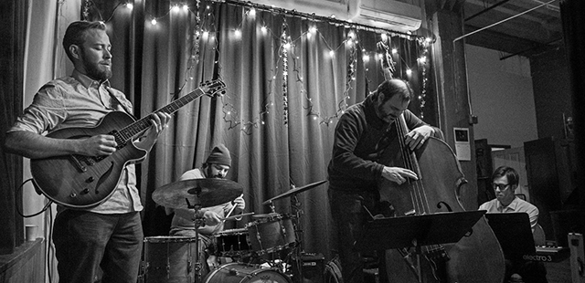 Left to right: Zacc Harris, JT Bates, Chris Bates and Bryan Nichols performing at the Black Dog.