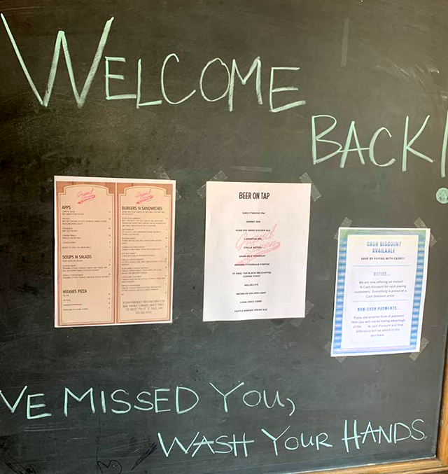 """Wash your hands"": A sign at the Grand Seven bar in downtown St. Paul greeted customers Monday afternoon."