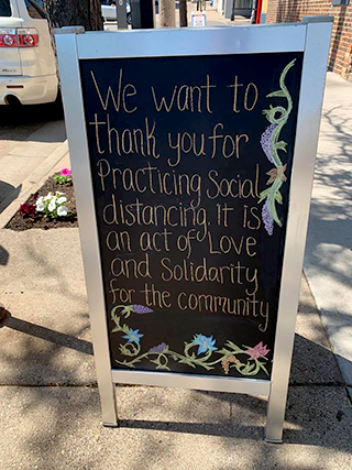 "A sign preaching ""love and solidarity"" greeted pub-goers to Tom Reid's Hockey City Pub in downtown St. Paul Monday."