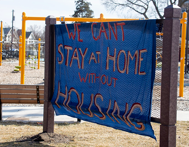 A sign calling for housing by the group Can't Stay Home Without Housing, who organized the emergency harm reduction shelter.