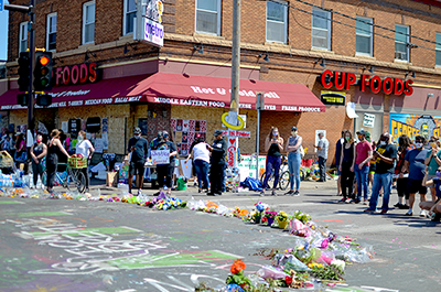 Memorials outside Cup Foods