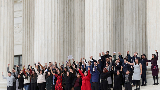 DACA plaintiffs walking arm-in-arm down from the U.S. Supreme Court last November.