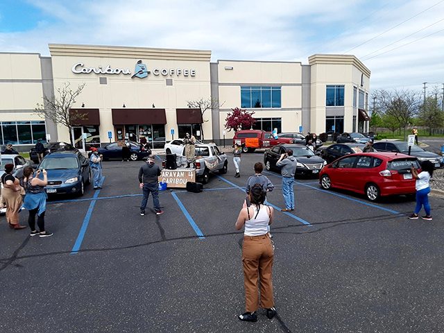 Caribou Coffee workers carry out a socially-distanced rally in Edina, asking for better benefits amid COVID-19.