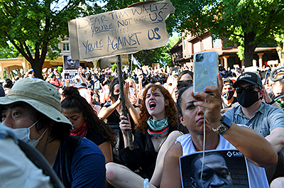 Protesters gather outside the Minnesota Governor's Residence